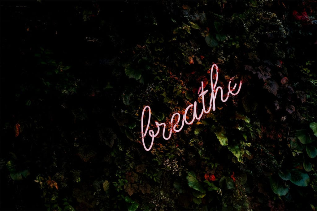neon sign of the word Breathe